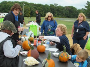 The kids enjoyed painting pumpkin at the walking path ribbon cutting event.