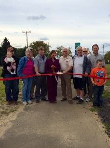 Freeholders Ben Laury and Julie Acton cut the ribbon on our new walking path. Oldmans Township Mayor Harry Moore and Deputy Mayor George Bradford with members of the community and Move Yourself! Salem County walking club assist with the ribbon cutting.