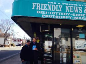 Owner, Vijay Shah, and Michael Hodges in front of one of the first stores to take part in the