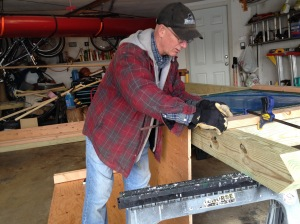 Dr. Jeff Hankinson works on the kiosk in his garage