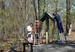 The kiosk takes shape as Dr. Jeff Hankinson and Peter Eliot constructing the  roof