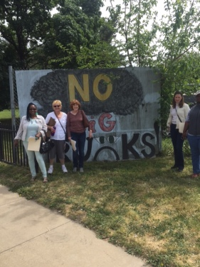 "Assessment participants stand in front of a sign that says ""NO BIG TRUCKS!"" Truck traffic has been a persistent issues in Waterfront South."